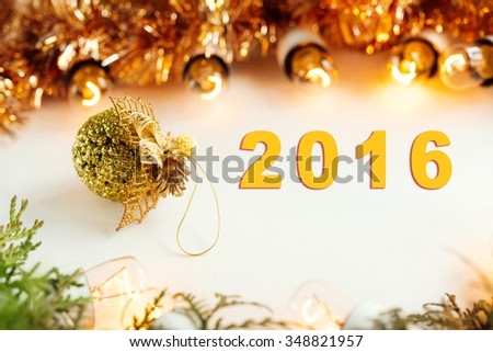 green branches and amazing christmas  vintage garland lights  and toy on white background, 2016 text