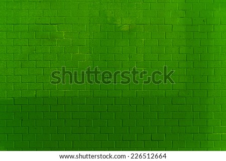 Green Brick Wall Pattern Texture as Urban background and backdrop. - stock photo