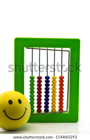 green Bright  toy abacus and yellow Smiling ball , isolated on white concept