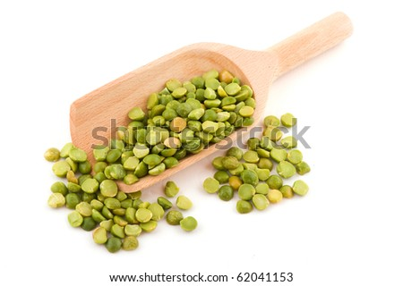 Green broken peas on wooden spoon isolated over white background - stock photo
