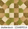 green brown quilt design on a piece of batting - stock photo