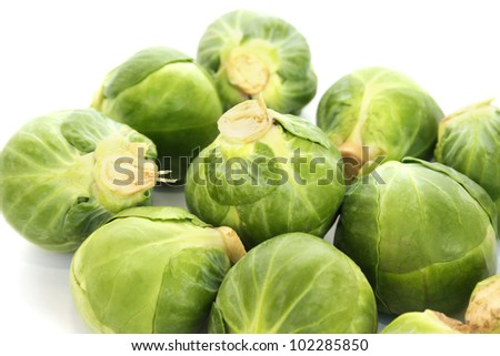 Green brussels sprouts on white background. - stock photo