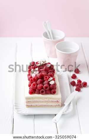 Green buckwheat cake with cream and fresh raspberries, selective focus - stock photo