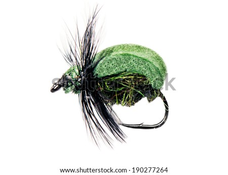 green bug fishing lure isolated over white - stock photo