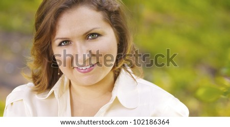 Green business concept. Outdoor portrait of a smiling business woman