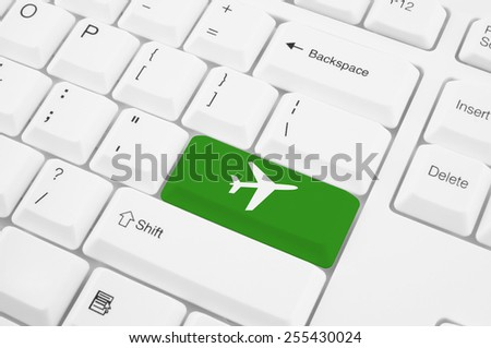 Green button with airplane symbol on the white keyboard                  - stock photo