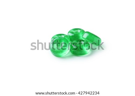 Green candies isolated on white - stock photo