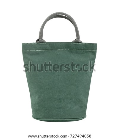Green canvas tote mini bag fabric for women shopping on white background, clipping path.