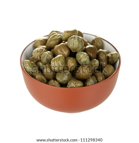 green capers in ceramical bowl isolated on white background - stock photo