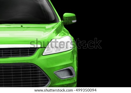 Green car on black background