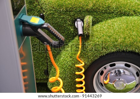Green car power refueling - ecology concept - stock photo