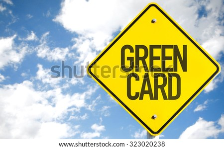 Green Card sign with sky background