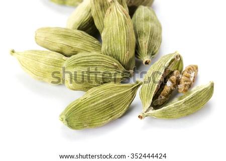 Green cardamom close up isolated on white background - stock photo