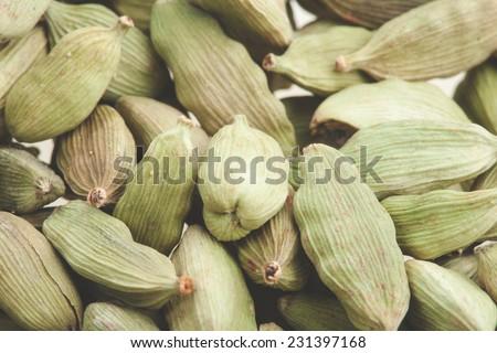 Green cardamom pods close-up. Macro photo - stock photo