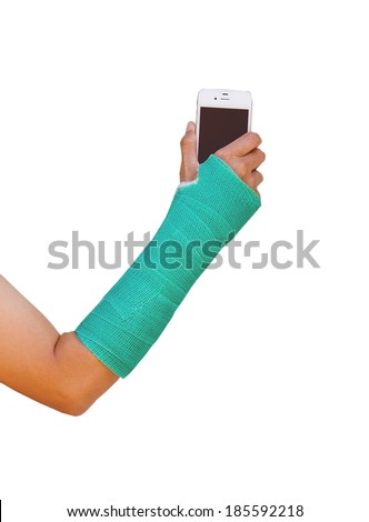 green cast on hand and arm, holding mobile phone isolated - stock photo