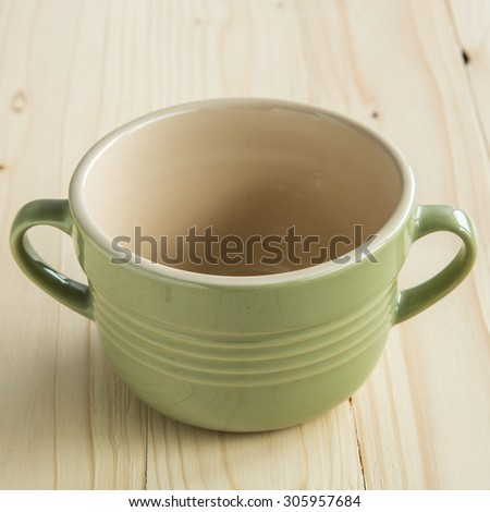 Green Ceramic Cup on Wooden Background - stock photo