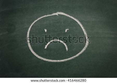 Green Chalkboard sad face - stock photo