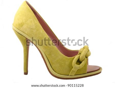 Green chamois female stiletto shoe on a white background - stock photo