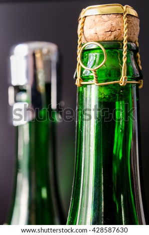 green champagne bottle with cork closeup - stock photo