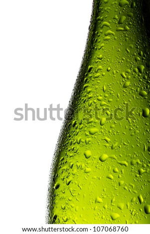 Green champagne bottle with water drops isolated on white background - stock photo