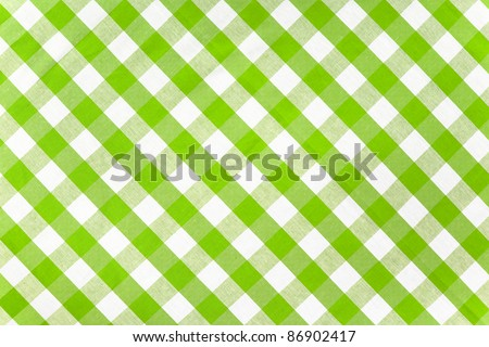 green checked fabric tablecloth - stock photo