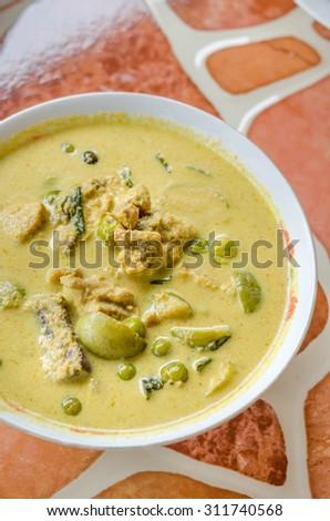 Green Chicken Curry in bowl on wooden background ,Thai cuisine