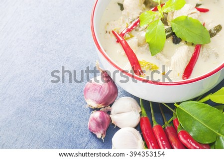 Green chicken curry with raw spicy ingredient Thai traditional food on light blue background - stock photo