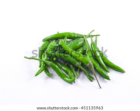 green chili peppers closeup view isolated white background