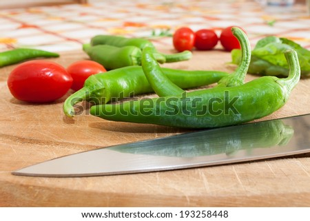 green chillies photographed on chopping board