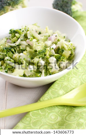 Green chopped salad with broccoli, onion and cucumber