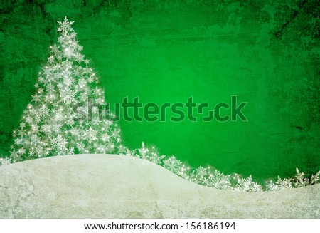green christmas background with snowflakes and pine tree - stock photo
