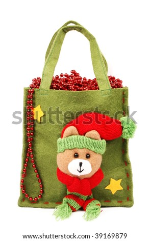 Green christmas bag and shiny red beads - stock photo