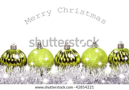 Green christmas baubles on a white background with space for text - stock photo