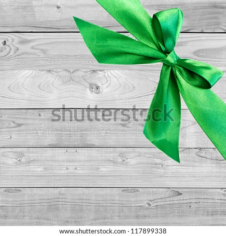 green Christmas bow on grunge wooden grey  background with space for text - stock photo