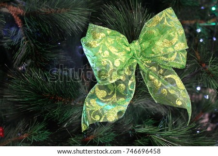 Green Christmas Bow on Tree