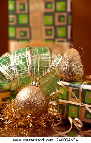 green Christmas gift boxes and Xmas golden decoration ball and golden and green  garland - stock photo