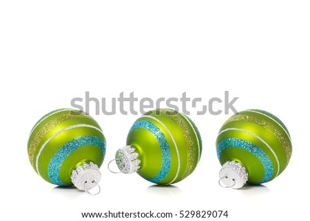 Green Christmas ornaments or baubles on white background with white copy space