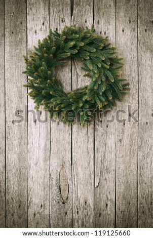 Green Christmas Wreath on Wooden Background - stock photo