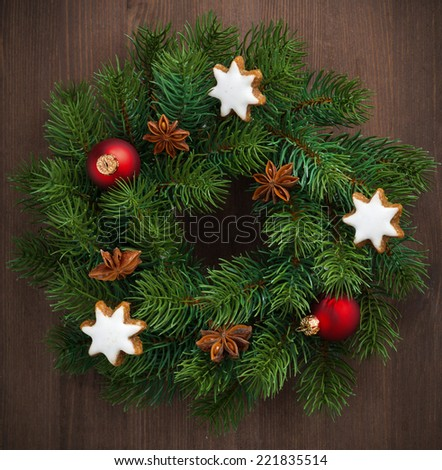 Green Christmas wreath with cookies and decorations, close-up, top view - stock photo