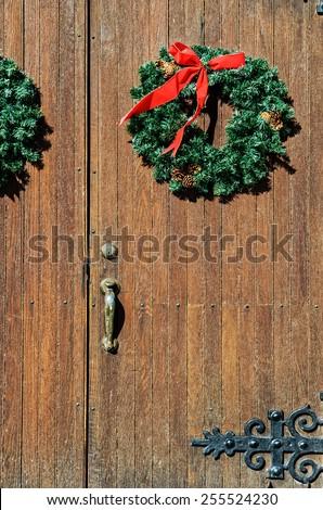 Green Christmas Wreaths on Vintage Wood Doors - stock photo