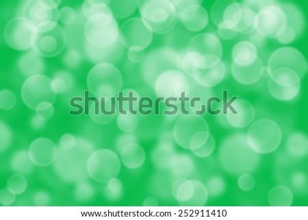 green circle shape boke as background - stock photo