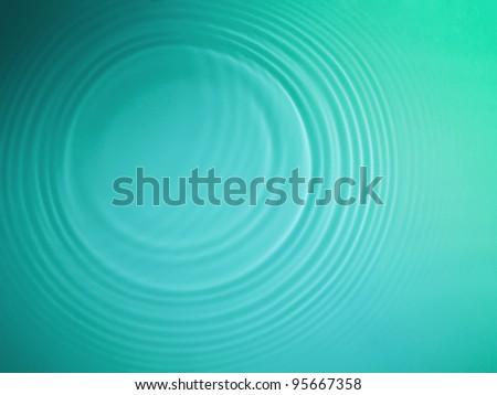 Green circle water ripple background - stock photo