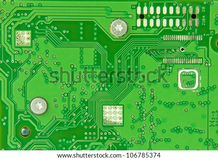 Green circuit board as the background - stock photo