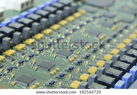 green circuit board with electronic components