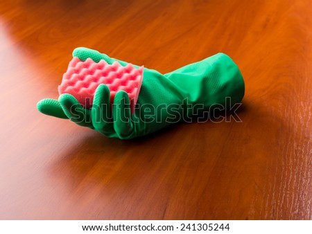 Green cleaning glove with a sponge  - stock photo
