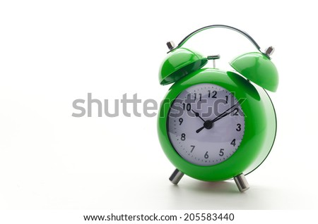 Green clock isolated on white