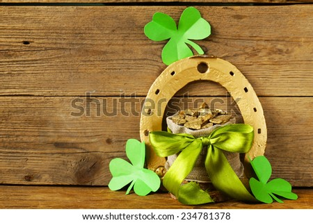 green clover leaves and a bag of gold - symbol of St. Patrick's Day - stock photo