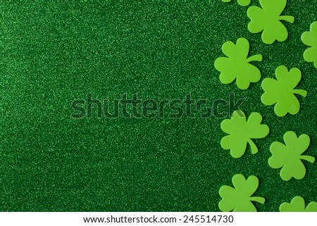Green Clovers or Shamrocks  on Green Background Background for St. Patrick's Day Holiday - stock photo
