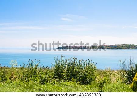 green coast and view of Tsarevo town - seaside resort on Black Sea coast in Bulgaria - stock photo