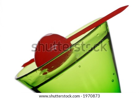 green cocktail with red cherry on a stick - stock photo